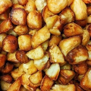 a big pile of crispy roast potatoes.